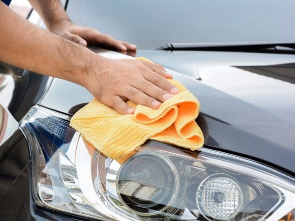 a-wash-towel-rubbed-on-a-car