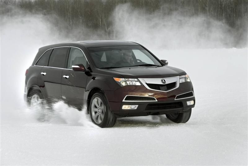 Acura-MDX-car-moving-on-snow