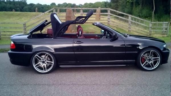 2005-BMW-3-series-convertible-with-open-doors
