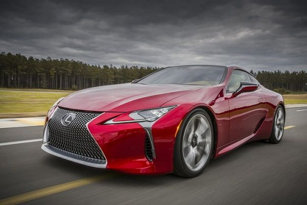 a-red-Lexus-LC500-cruising-on-the-road