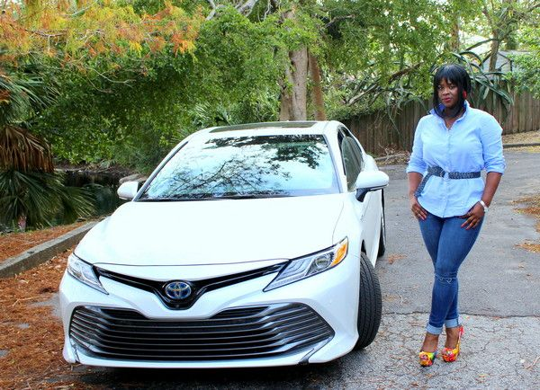 A-lady-standing-next-to-a-2018-Toyota-Camry