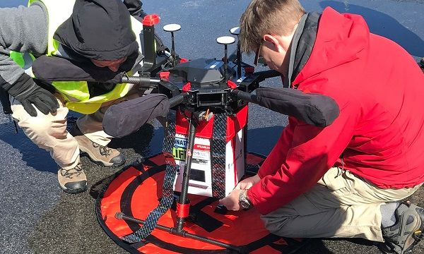 image-of-maryland-scientists-around-drone