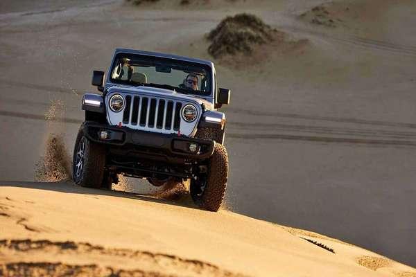Wrangler-driving-through-sandy-terrain