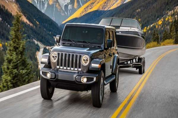 2019-Jeep-Wrangler-towing-a-boat
