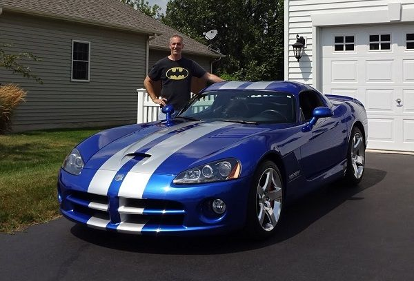 Man-stands-with-a-2006-Dodge-Viper-SRT-10