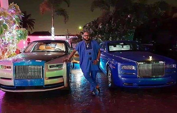 E-money-posing-with-his-Rolls-Royce-cars