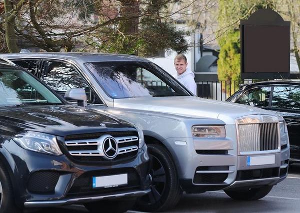 Matej-Vydra-getting-into-his-Rolls-Royce-Cullinan
