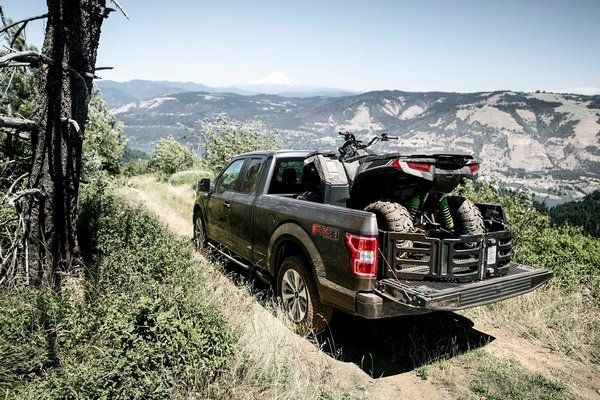 F-150-driving-up-a-hilly-path