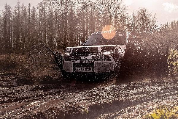 land-rover-defender-through-mud