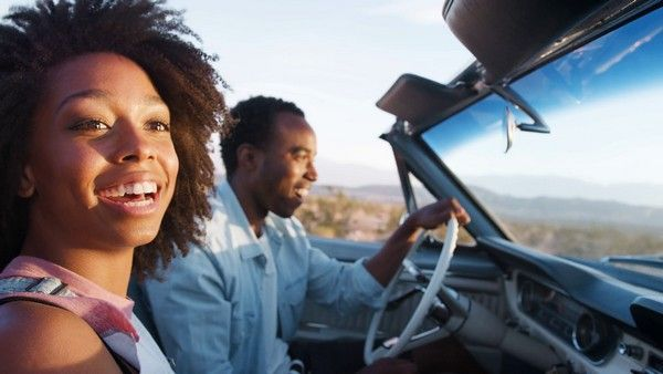 Black-couple-driving-together
