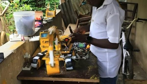 Hope-Emmanuel-working-in-his-home