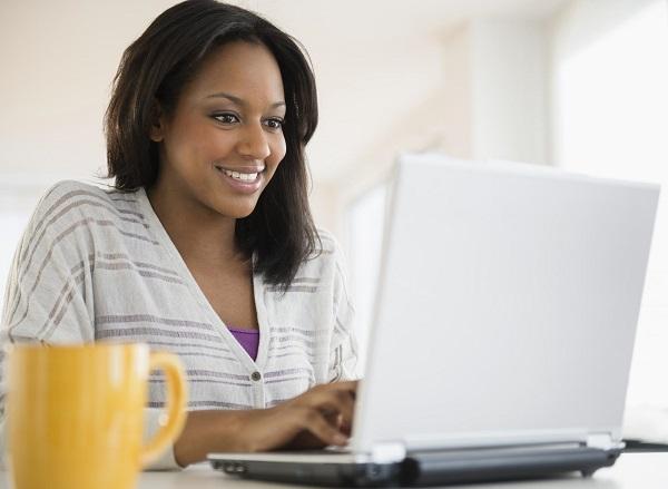 Young-woman-checks-computer-screen