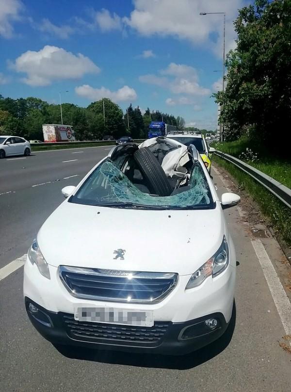 trailer-tyre-crashed-peugeot-car