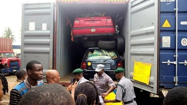 Custom-officers-inspect-cars-in-container