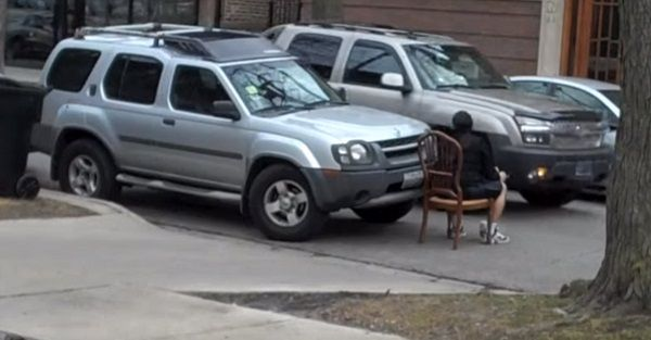 man-sits-in-front-of-car