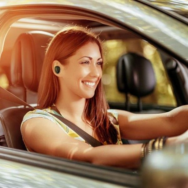 girl-with-bluetooth-earpiece-in-car