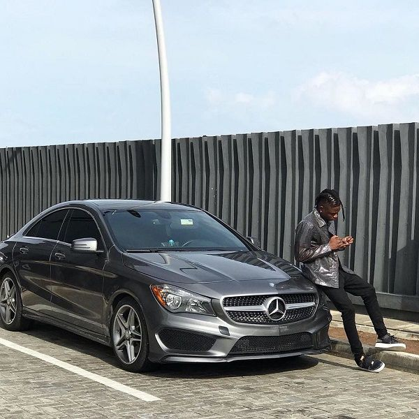 Lil Kesh-showing-off-his-new-Mercedes-Benz