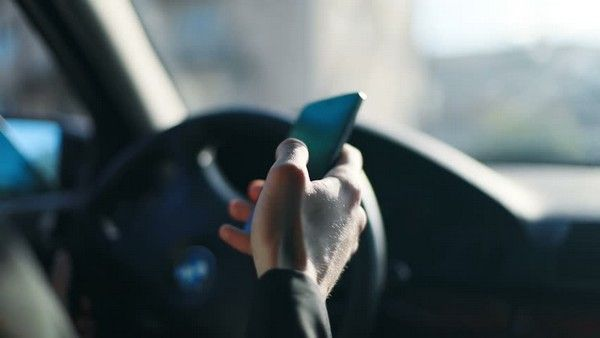 Checking-mobile-phone-while-driving