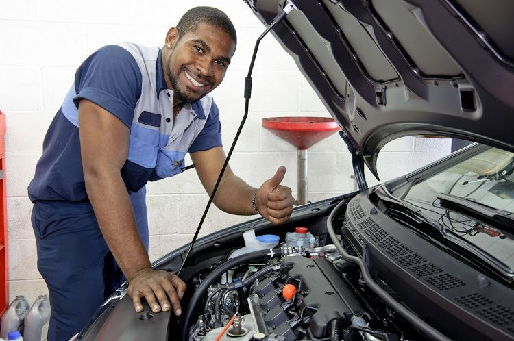 A-professional-mechanic-working-on-a-car