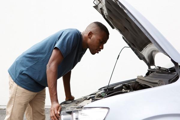 Black-man-checking-car