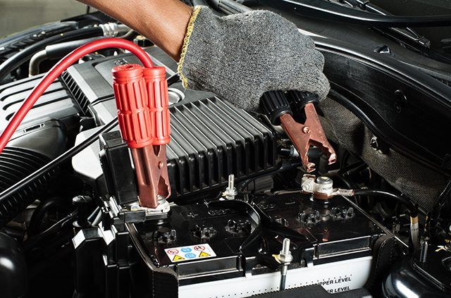A-car-battery-charger-plugged-into-a-car