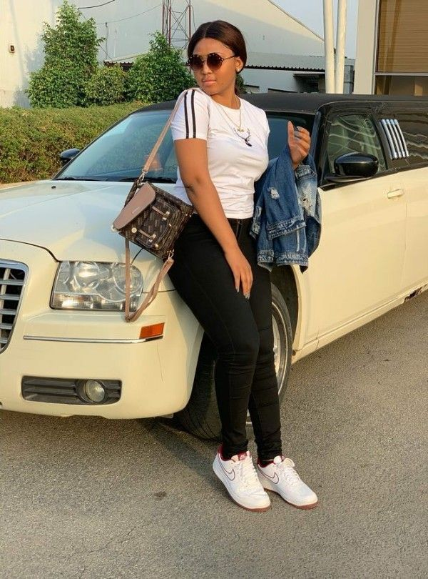 Regina-Daniels-poses-with-Chrysler-300c-Limousine