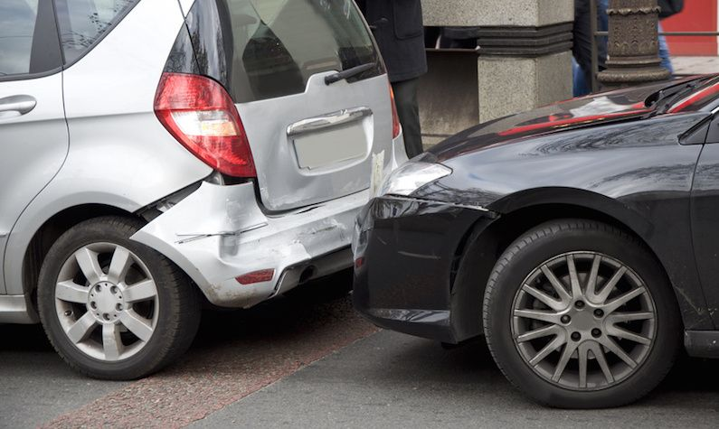 A-car-showing-its-damaged-bumper-by-another-car