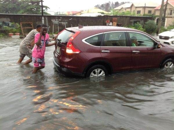 two-nigerian-men-pushing-a-car