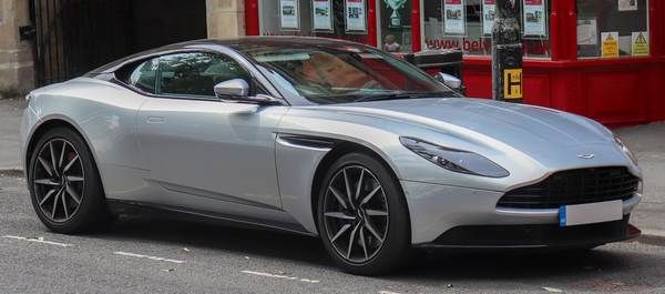 Aston-Martin-DB11-parked-in-front-of-store