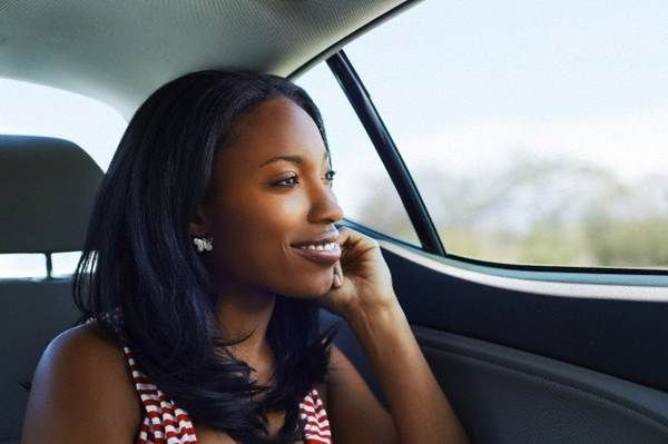 worman-looking-out-of-the-car-window