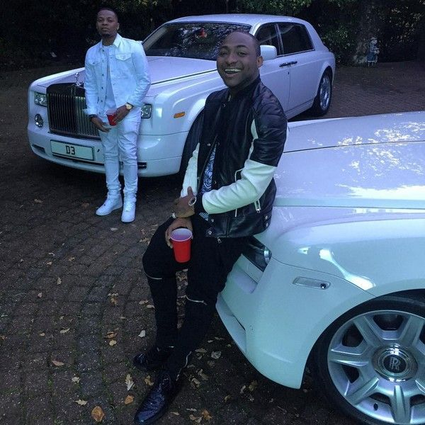 Davido-and-Olamide-chilling-with-their-Rolls-Royce.
