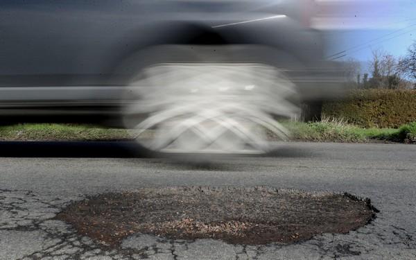 car-overspeeding-through-potholes