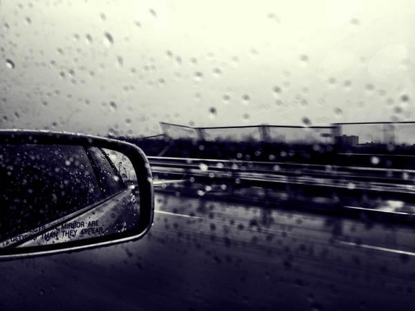 car-running-in-storm