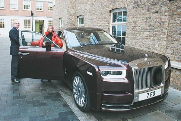DJ-CUPPY-with-her-Rolls-Royce-Phantom-VIII