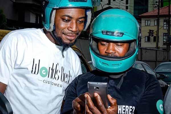 GOkada-driver-and-passenger-checking-out-mobile-app