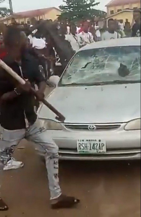 students-destroying-car