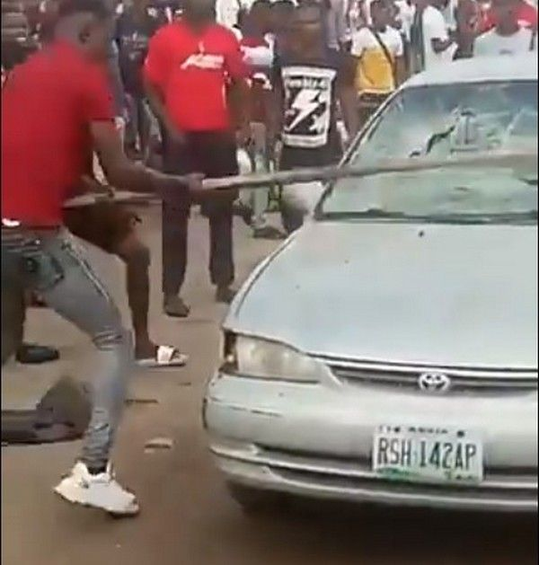 students-destroying-car-of-officials