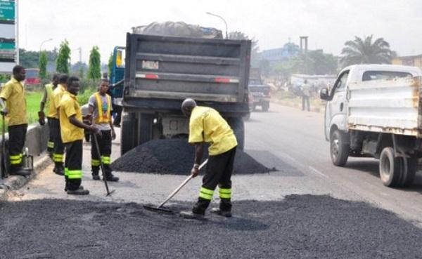 men-repair-a-road