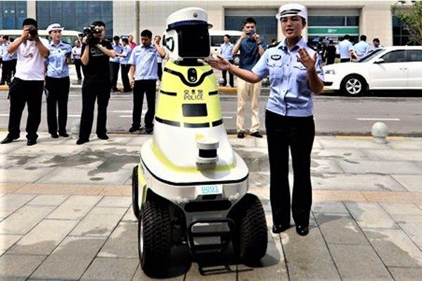 Human-officer-presents-Robot-traffic-police-in-China