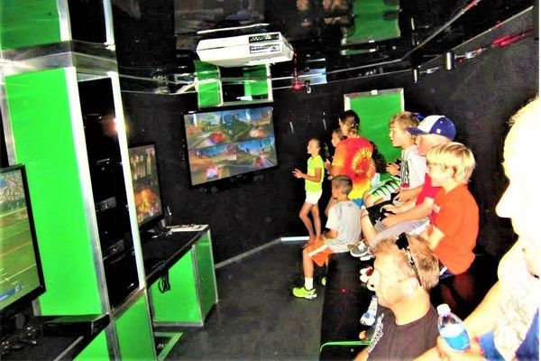 Large-screens-and-games-inside-Thrillz-On-Wheelz-mobile-entertainment-theater-03