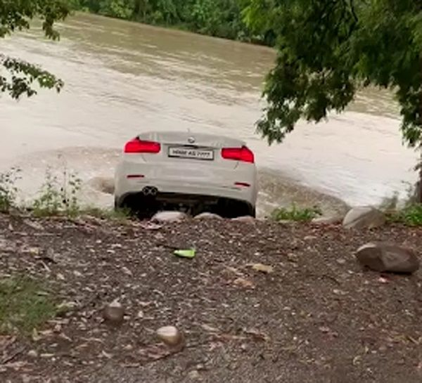 BMW-pushed-into-river