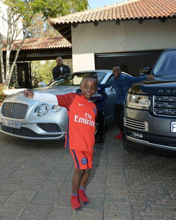 Alph-Lukau-his-car-and-his-family-members