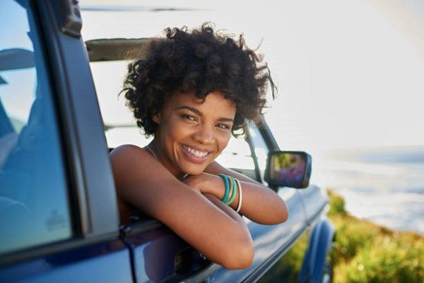 woman-leans-out-of-car