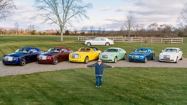 Michael-Fux-poses-with-his-Rolls-Royce-car-collection