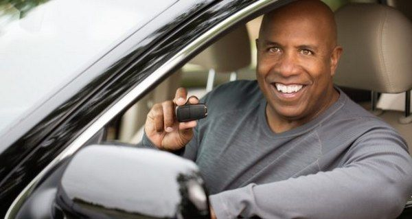 man-holding-a-car-key