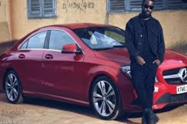Sarkodie-with-his-red-Mercedes-E-Class-Coupe