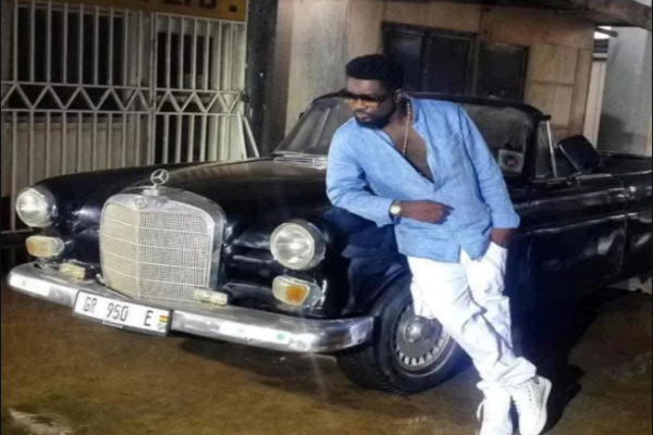 Sarkodie-with-his-1965-Mercedes-Benz-W110
