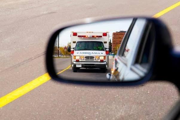 image-of-ambulance-through-reverse-car-mirror