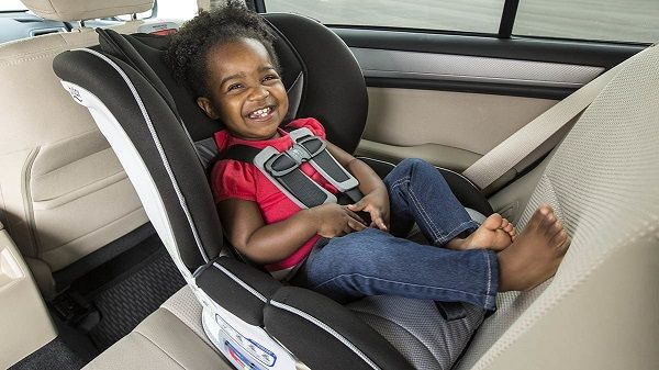 Kid-strapped-to-backseat-of-a-car