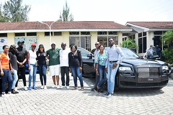 Coscharis-Motors-team-poses-with-new-rolls-Royce-black-badge